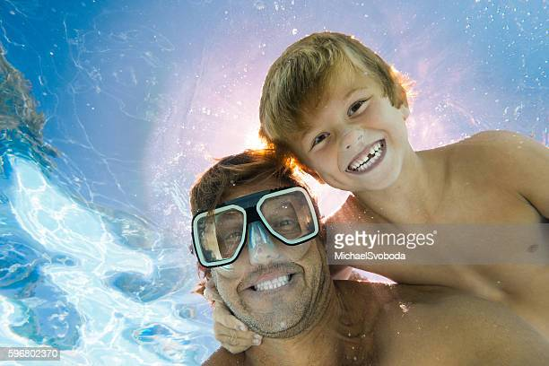 Dad and Son Having Fun Doing A Selfie Underwater