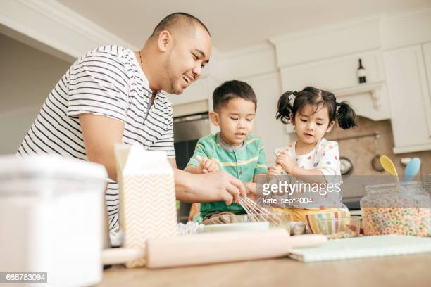 Dad baking with kids