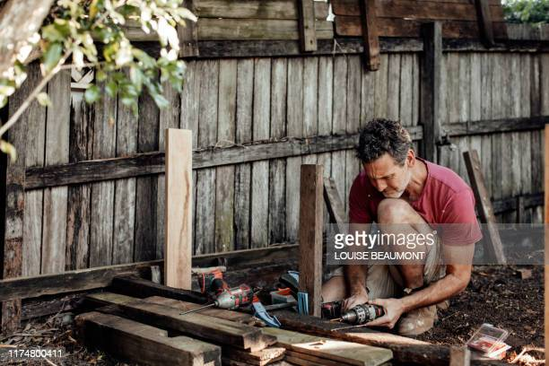 dad builds a raised vege garden - effort stock pictures, royalty-free photos & images