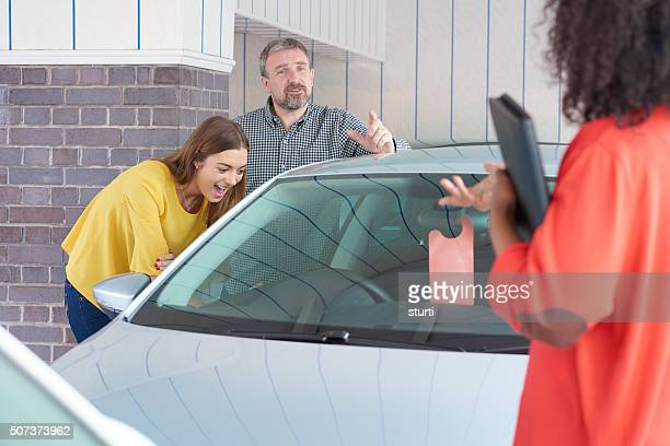 Dad buying a second hand car for his daughter