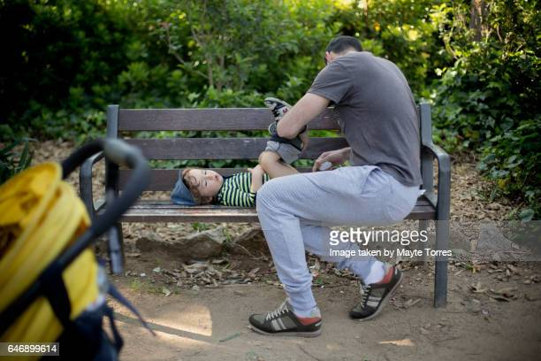 Dad changing a nappie at the park