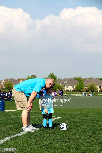 Dad coaching son in soccer