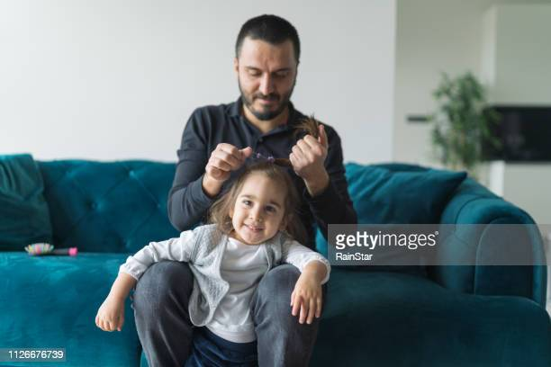 dad combing daughters hair in the morning - beautiful turkish girl stock pictures, royalty-free photos & images