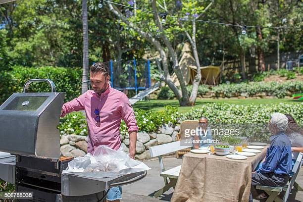 Dad cooking on barbecue for lunch