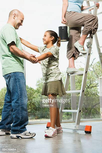 Dad Dancing with Daughter During Home Project