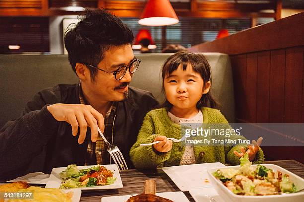 Dad & daughter enjoying meal in restaurant