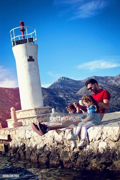 Dad, daughters and lighthouse
