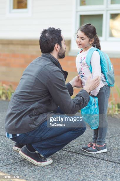 Dad drops his little girl off at school