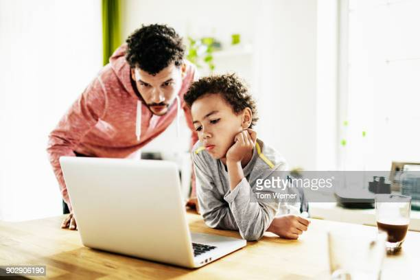dad helping his son with homework - north african ethnicity stock pictures, royalty-free photos & images