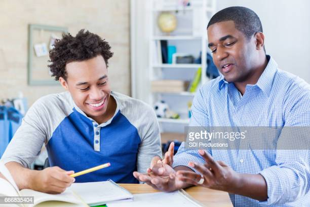 dad helps teenage son with homework - idol stock pictures, royalty-free photos & images