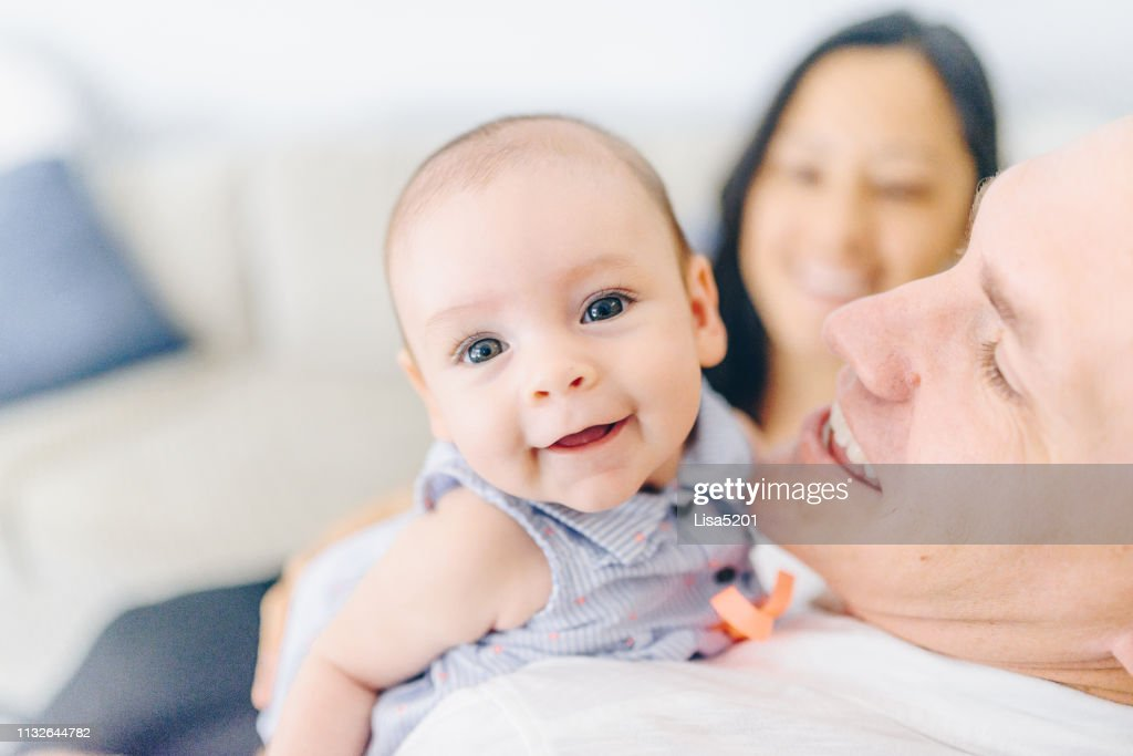 Dad Holding 4 Month Old Baby Girl Stock Photo - Getty Images