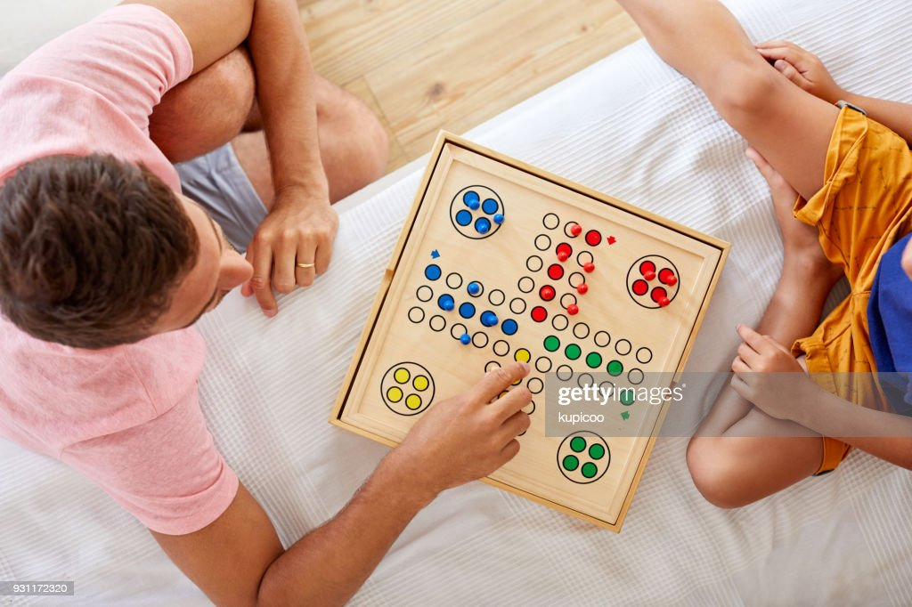 Dad is the best at board games : Stock Photo
