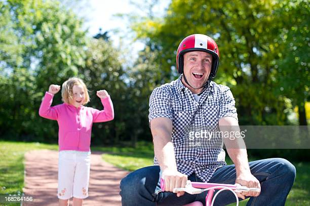 Dad learns to ride a bike