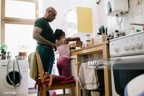 Dad Letting Young Daughter Help Out In The Kitchen