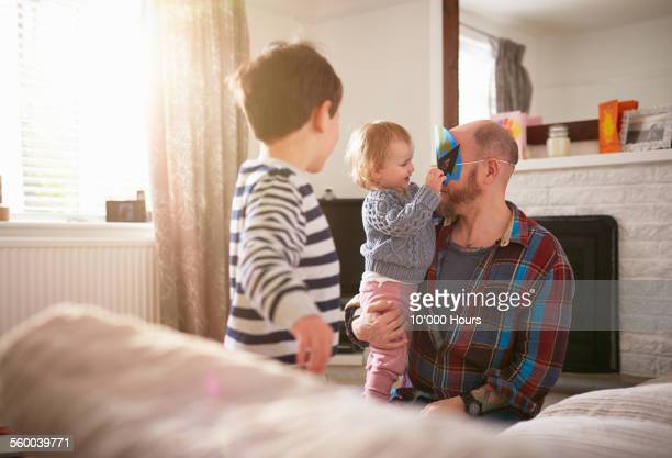 Dad play with his kids