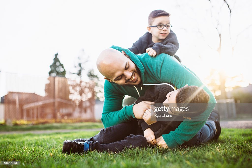 Dad Playing Outside with His Boys : Stock Photo