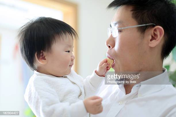 Dad playing with a little baby