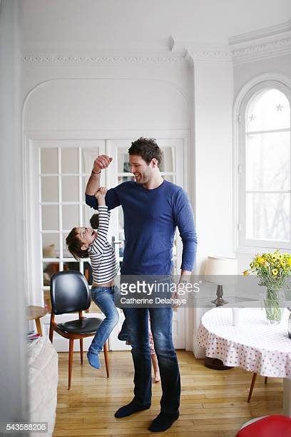 A dad playing with his 5 years old son