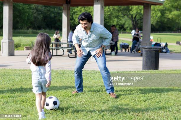 dad plays soccer with young daughter - niece stock photos and pictures