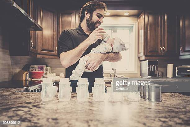 Dad Preparing Baby Bottles
