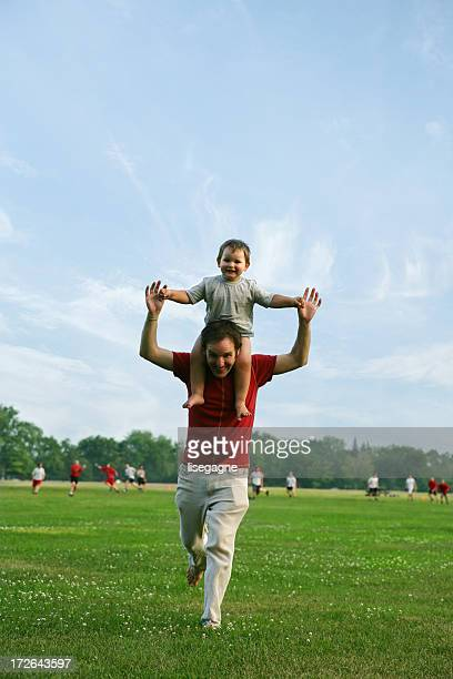 Dad running with son