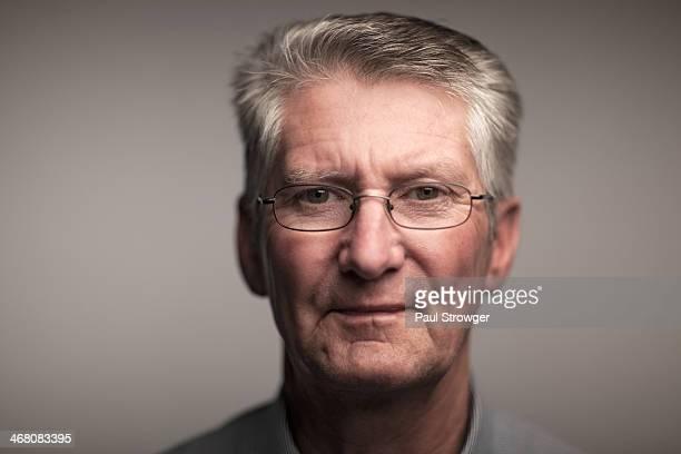Dad, shallow DoF on a grey background.