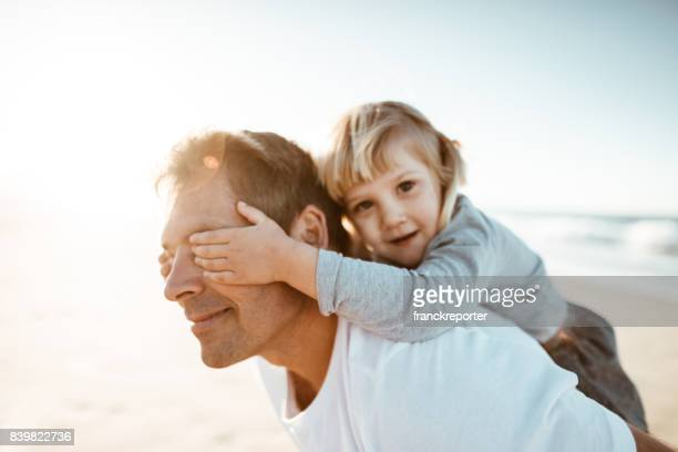 dad take daughter on piggyback - prop stock pictures, royalty-free photos & images