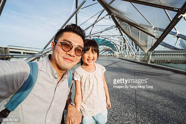 Dad talking selfie with daughter joyfully