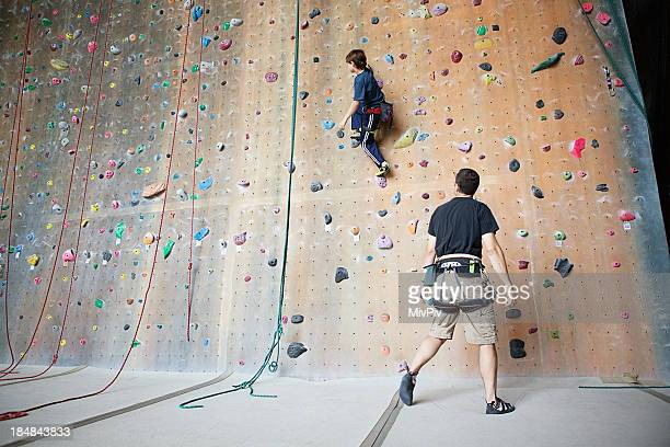 Dad teaching his son to rockclimb