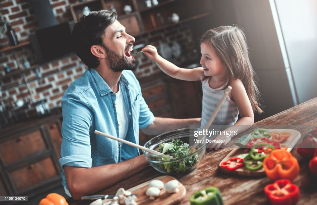 Dad with daughter on kitchen : Stock Photo