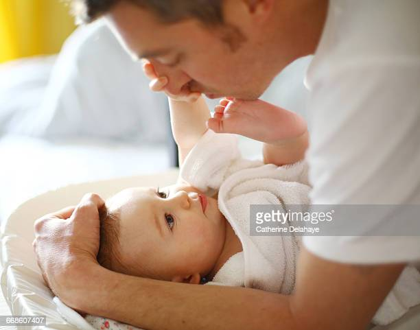 A dad with his baby on the changing table