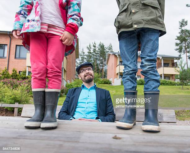 Dad with kids enjoying outdoors.