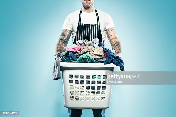 dad with tattoos does laundry - chores stock pictures, royalty-free photos & images