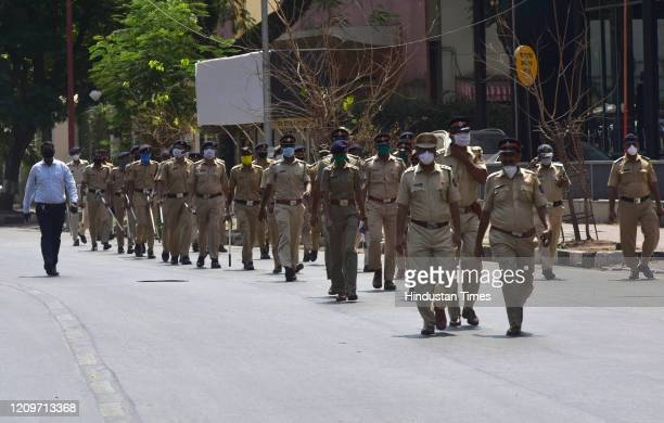 Dadar police station hold flag march appealing people to stay home during nationwide lockdown due to COVID 19 pandemic at Worli on April 11 2020 in...