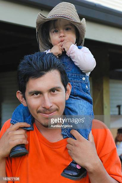 daddy and me - migrant worker stock photos and pictures