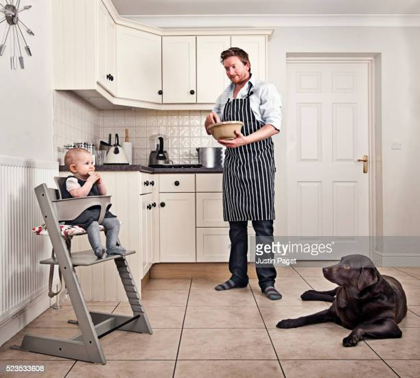 daddy day care - father baking in kitchen - dog eats out girl stock pictures, royalty-free photos & images
