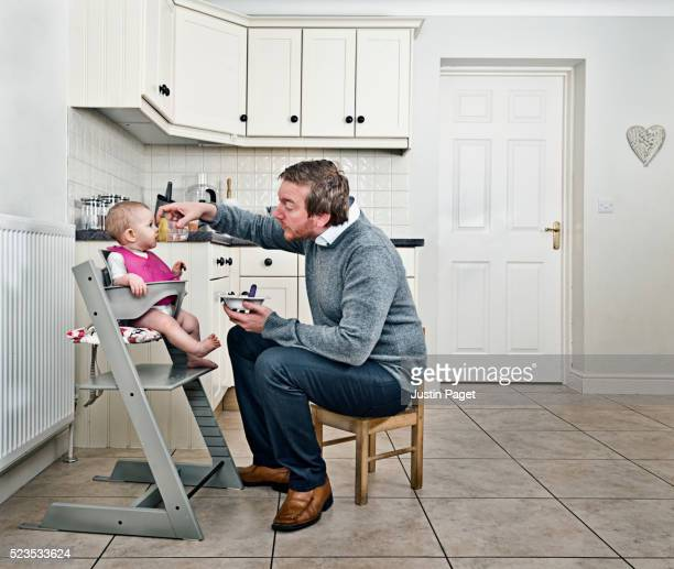 Daddy Day Care - Father Feeding Baby in Kitchen