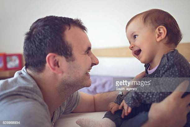 Daddy entertains baby
