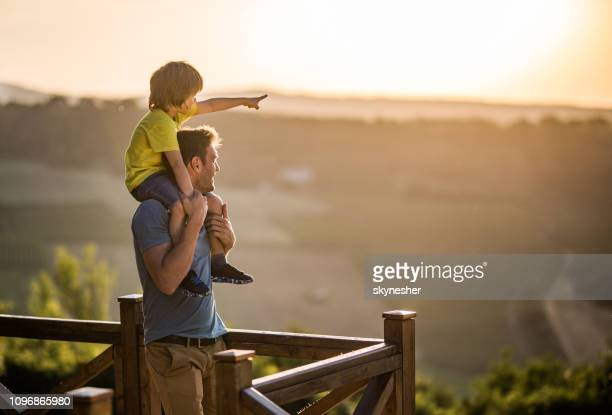 daddy, look over there! - aiming stock pictures, royalty-free photos & images