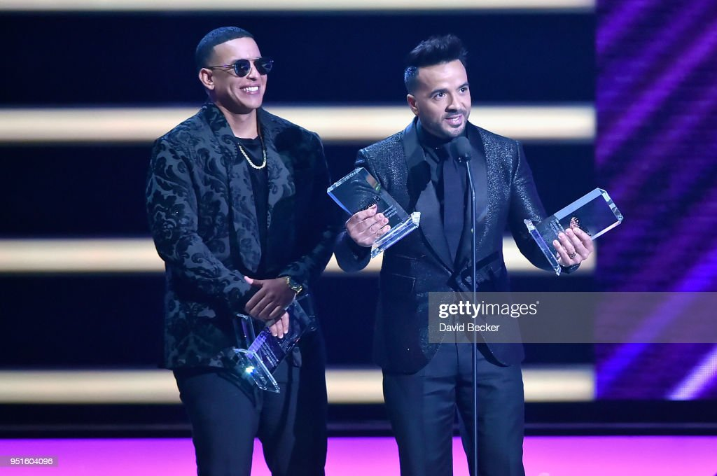 Daddy Yankee (L) and Luis Fonsi onstage at the 2018 Billboard Latin Music Awards at the Mandalay Bay Events Center on April 26, 2018 in Las Vegas, Nevada.