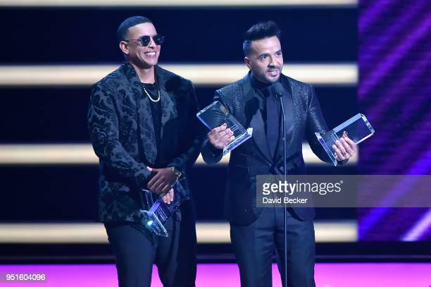 Daddy Yankee and Luis Fonsi onstage at the 2018 Billboard Latin Music Awards at the Mandalay Bay Events Center on April 26 2018 in Las Vegas Nevada