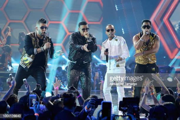 Daddy Yankee Arcangel and KenY perform on stage at Univision's Premios Juventud 2018 at Watsco Center on July 22 2018 in Coral Gables Florida