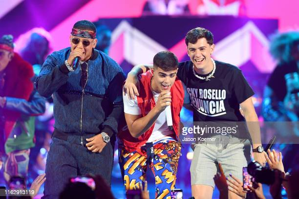 Daddy Yankee Lunay and Guaynaa perform on stage during Premios Juventud 2019 at Watsco Center on July 18 2019 in Coral Gables Florida