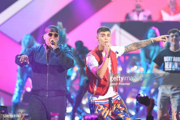 Daddy Yankee Lunay perform on stage during Premios Juventud 2019 at Watsco Center on July 18 2019 in Coral Gables Florida