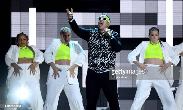 Daddy Yankee performs with dancers during the 2019 Billboard Latin Music Awards at the Mandalay Bay Events Center on April 25 2019 in Las Vegas Nevada