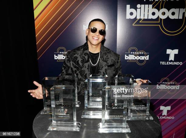 Daddy Yankee poses with his awards backstage at the 2018 Billboard Latin Music Awards at the Mandalay Bay Events Center on April 26 2018 in Las Vegas...