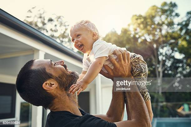 daddy's big boy - candid stock pictures, royalty-free photos & images