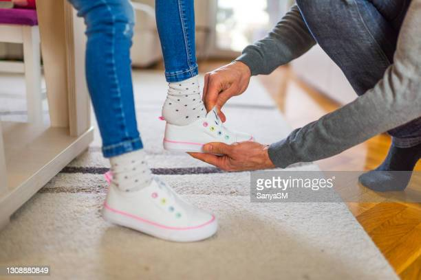 daddy's girl getting ready for school - school girl shoes stock pictures, royalty-free photos & images