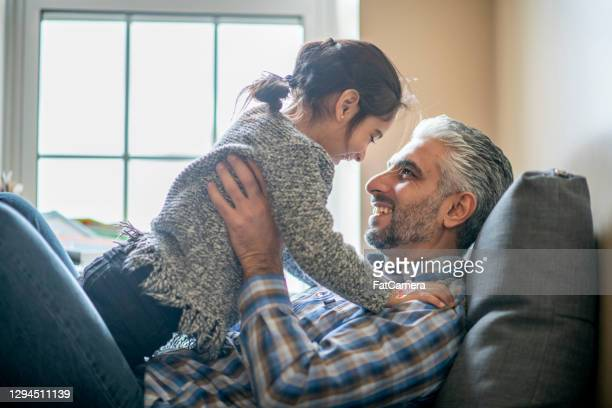 daddy's girl - refugee stock pictures, royalty-free photos & images