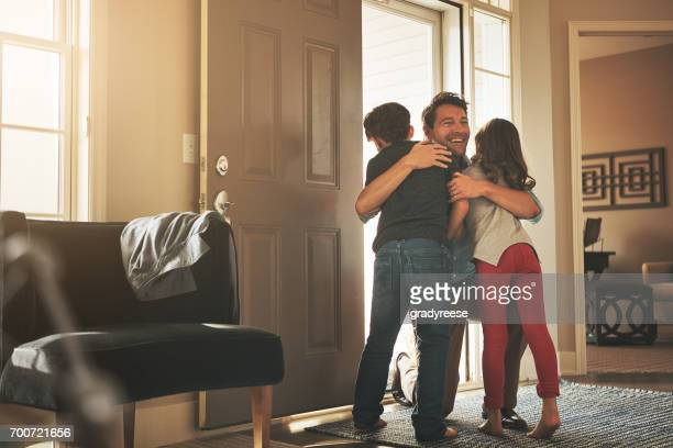 daddy's home! - embracing stock pictures, royalty-free photos & images
